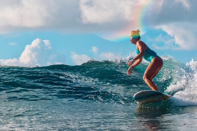 Woman Surfing At Malibu Popoyo Resort in Nicaragua