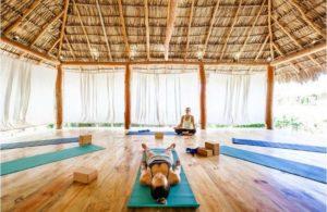 2 women practicing yoga on yoga mats in Nicaragua