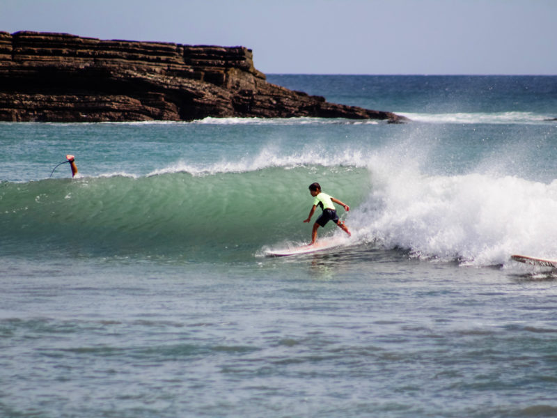 Child surfing at Magnific Rock